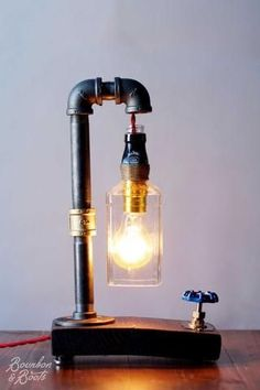 A Bourbon lover is passionate about their whiskey. They eat, sleep and breathe whiskey. The best 10 whiskey must have gifts for people who love their bourbon. Industrial Bathroom Lighting, Industrial Table, Whiskey Bottle Crafts, Bourbon And Boots, Retro Lighting, Lighting Ideas, Lighting Design, Bottle Lights, Bottle Lamps
