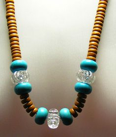 Turquoise, Lucite and wood beads make up this lovely necklace. $15.40