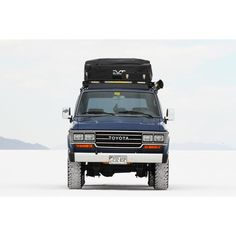 Blue FJ62 Toyota Land Cruiser with RTT