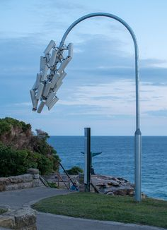 jakub geltner has installed a colony of CCTV cameras on a street pole as part of sculpture by the sea in bodni beach.