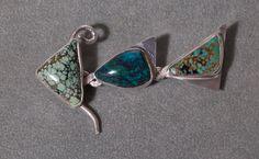 BIG Sterling Silver and Turquoise Fish Pin One of A Kind Peacock Kingman & Bisbee. $199.99, via Etsy.