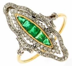 Antique Emerald and Diamond ring, c. 1900. Beautifully carved pierced out marquise shaped ring. Double row of diamonds set in platinum, combined weight 1.20ct. Rectangular emeralds to centre in a fine yellow gold channel, 0.60ct. Diamond set shoulders and gold shank.