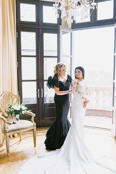 real wedding photo at oheka castle long island new york classic wedding portrait mother of bride black gown bow sleeves with daughter in wedding dress