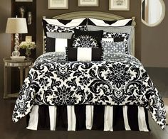 Love this Damask bedding.  Going with damask, stripes, polka dots - all in black and white