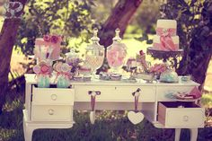 What I like here: 1) using old desk instead of table 2) cotton candy in vintage jar 3) pink & mint green colour combo.