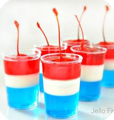 These look amazing. Red, White & Blue Jello shots topped with a cherry.