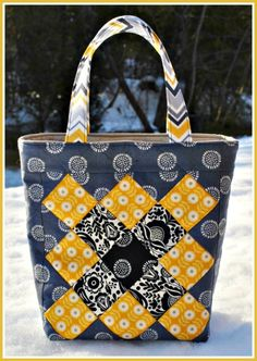 A smaller patchwork tote designed by Sweet Jane that is perfect for carrying books, your wallet, and keys while running quick errands. These patchwork tote bags are