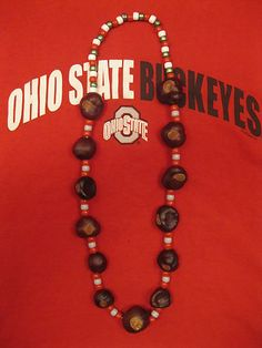 Buckeye necklace idea for Daisys.....red, grey beads, drill holes in buckeyes, let them dry out for a couple of days, then string them all on a shoelace...
