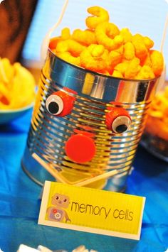 serve food in tins, but fruit or veggies instead of cheese doodles