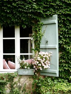 Ivy covered, shuttered, French home of designer Double Merrick.