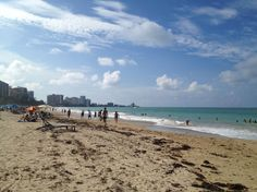 In this Oct. 2014 photo, beachgoers enjoy the sun and sand at Isla Verde Beach in San Juan, Puerto R... - AP Photo/Kristi Eaton