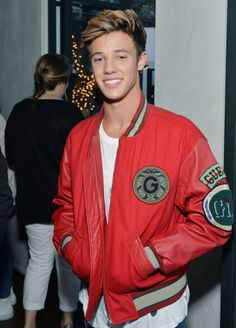Cameron Dallas in a one-of-a-kind vintage #GUESS1981 Varsity Jacket from the archives at the #GUESSDare Fragrance Party