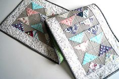 Quilted Patchwork Table Runner in Colorful Modern Fabrics by MyBitOfWonder on Etsy https://www.etsy.com/listing/252138963/quilted-patchwork-table-runner-in