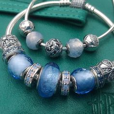 Pandora Essence beads for today are Freedom and Patience and my favourite Cinderella's colour Murano on my bracelet with sparkling Daisy Clips. Calming , heavenly blues for the first day of my work week. #pandora #blue #lace #agate #freedom #patience #happiness #joy #essence #dazzling #daisy #emerald #leather @handbag_butler Best Buy at @bradshaws1895 January Sale