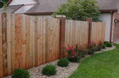 Wood fence with brick columns. #TopekaLandscape