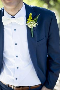 baby blue pinstripes, navy suit, white bow tie, baby daisy boutonniere.                                                                                                                                                     More