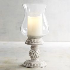 Brighten your decor with the elegant design of our hand-carved hurricane and enjoy the perfect ambience of candlelight anytime.