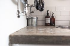 Downstairs Bathroom with concrete worktops, leather captain's mirror and matt smooth subway tiles with grey grout
