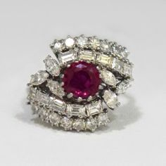 Exquisite High Quality Natural Ruby And Diamonds 18k Gold Ring-$5000.00  This gorgeous ring is beautifully crafted in 18k solid white gold and features an glamorous AAA quality 1.2ct vintage-cut natural ruby. The ruby is surrounded by 2.43ctw vintage-cut diamonds VS2 in clarity and D in color. This is a heirloom quality jewelry piece that will make a great addition to your jewelry collection. The ring is size 6 and is sizable.