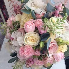 Bridal bouquet using Avalanche roses, Bombastic spray roses, snowberry, Astilbe  and Scabious.