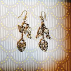 Juicy Lock & Key Heart Dangle Earrings! Juicy Couture Lock & Key Heart Dangle Earrings! Only worn a few times, in great condition  originally purchased at Nordstrom's. Juicy Couture Jewelry Earrings