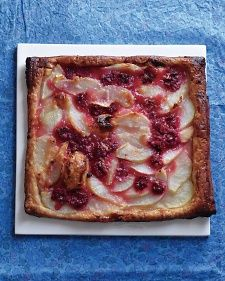 Store-bought puff pastry is an effortless base for this pretty tart. The brightness of berries is wonderful with mellow pears.