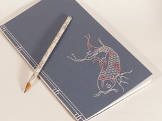 Embroidered Japanese Notebook / Koi Fish on Blue, via Etsy. Japanese Koi, Japanese Books, Japanese Style, Japanese Stab Binding, Japanese Notebook, Koi Fish Designs, Poetry Journal, Japanese Embroidery, Handmade Books