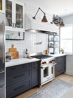 Here, an entire wall, including the range hood, is clad in a classic white subway tile. | Design: Qanuk Interiors | Photo: Valeri Wilcox