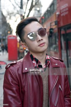 The Bold Concept founder Jocelyn Yih wears a Zara biker jacket, Raf Simons shirt, Prada jumper, and Dior sunglasses on day 3 of London Collections: Men on Januay 10, 2016 in London, England.