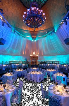 Up-Lighting Walls and Canopies - the colored lights project upward onto the ceiling, and the sheer drapes add more color and texture.