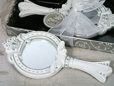 Sparkling Tiara Hand Mirror Favors (Cassiani Collection 1649) | Buy at Wedding Favors Unlimited (https://www.weddingfavorsunlimited.com/sparkling_tiara_hand_mirror_favors.html).