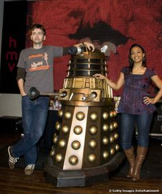 David Tennant And Freema Agyeman posed with a Dalek during a signing session for the DVD box...