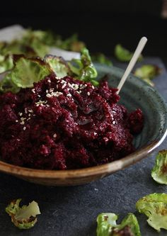 This roasted garlic beet hummus is served with crispy brussels sprouts chips for a low carb alternative to the favorite appetizer spread.
