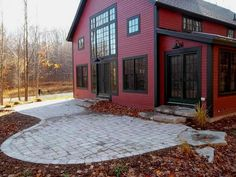Red metal siding gray trim barn exterior Post & Beam Barn Home by Yankee Barn Homes...love this look
