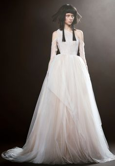 ENGLANTINE is a light ivory V-neck silk mermaid wedding gown with illusion high neck accented by hand placed Chantilly lace applique by Vera Wang.