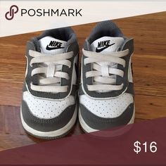 Infant nikes Gray white and black infant nikes. Does slip on with faux elastic laces. EUC. My son wore these before he could walk. Nike Shoes Sneakers