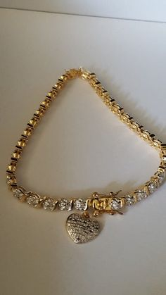 "Precious Bracelet, 925 Sterling Silver, covered in 10k gold, Zirconia Diamonds, 11.32grs Sz 8""inches"