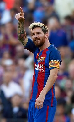 Lionel Messi of FC Barcelona celebrates scoring his team's fourth goal during the La Liga match between FC Barcelona and RC Deportivo de La Coruna at...
