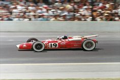 Jim Clark at speed on track at IMS in 1966