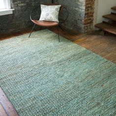 8x11  $726 Appearing to be a solid color at first glance, subtle variegations on the Tropic rug lend sophistication and depth. Anchor a sitting area around the cool neutral hues of this seafoam green area rug, perfect for traditional or contemporary interiors. Hand woven from 100% jute, this rug steps up with beautiful design and quality crafting to be a favorite for years to come.