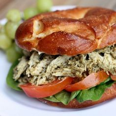 Shredded chicken salad mixture with homemade pesto, served with mozzarella, tomato, and spinach on a crusty roll.