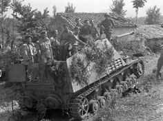"""Soldiers of the 5th Canadian Tank Brigade in the fighting compartment of German self-propelled guns """"Nashorn"""" padded out bazooka on the street Italian village Pontecorvo"""