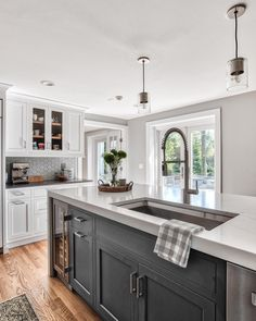Grey kitchens will never go out of style. These 25  photos of kitchens with gray cabinets will inspire you to embrace this trendy neutral. We're going over painted gray cabinets, farmhouse grey kitchens, dark gray kitchens, modern kitchens,   more! Visit our blog to get inspired. . . . . . . . . . . . . . #KitchenCabinets | Grey Cabinets | Gray Cabinets | Painted | Light | Country | With Granite | Black Countertop | Wall Color | Blue | Butcher Block | Gold Hardware | Distressed | DIY…