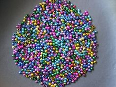 '500 Rainbow Shiny Beads  Size 2 mm' is going up for auction at  1pm Tue, Nov 13 with a starting bid of $8.