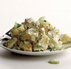potato salad - Yukon Gold potatoes with onion, celery, hard-cooked eggs, and capers in a sour-cream Champagne vinegar dressing.