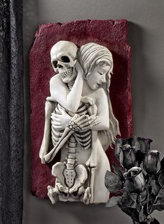 Life embraces death in this almost two-foot-high skeleton wall sculpture. The blood red background and alabaster flesh encircles a bony skeleton in a bas relief sculpture. Medieval Gothic, Victorian Gothic, Goth Home Decor, Animal Statues, Gothic House, Gothic Room, Up Girl, Art Plastique, Wall Sculptures