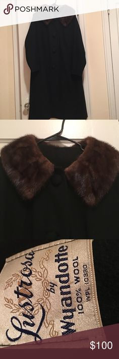 Vintage 1950s Wyandotte coat with fur collar Purchased at a vintage store in Maryland. Very darling coat, and very warm. 100% wool. There are no sizing details but it is a roomy cut and would best fit sizes 4-10 (or smaller sizes for an oversize look). One hole near the back hem, as pictured. Not sure what the fur is but I would guess mink? Measures 41 inches long and 21 inches armpit to armpit. Vintage Jackets & Coats