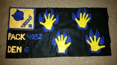 Wolf den flag that I made for my son's cub scout den. Made with felt. The den leader gave me the boys hands and I sewed them on top of wolf prints I made.
