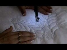 Donna Ward from Donna's Quilt Studio in Hamilton, New Zealand, shows how she free form machine quilts sprials and feather designs. This is a simple yet effective quilting pattern.