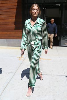 Gigi Hadid gives us a lesson in the pajama trend with this green and white striped set while out in New York City.